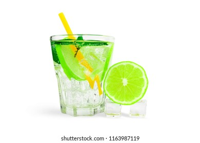 glass of soda water with ice cubes, lime and mint. Isolate on white background