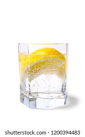 glass with soda water and lemon slices on white background