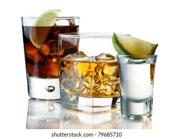 Glass of soda, whiskey on the rocks, tequila shot