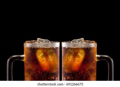 Glass of soft drink on black background