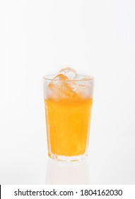 Glass of softdrink with reflection on white background.