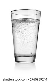 Glass of sparkling water with bubbles of gas isolated on white background.