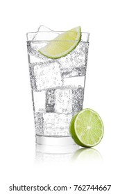 Glass of sparkling water soda drink lemonade with ice and lime slice on white background