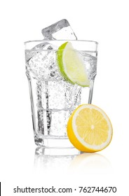 Glass of sparkling water soda drink lemonade with ice and lime lemon slice on white background