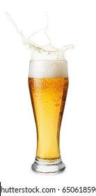 glass of splashing beer isolated on white background