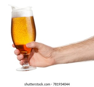 glass of splashing beer isolated on white background. Male hand making toast