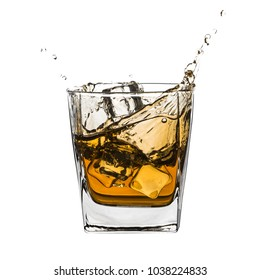 Glass of splashing whiskey with ice isolated on white