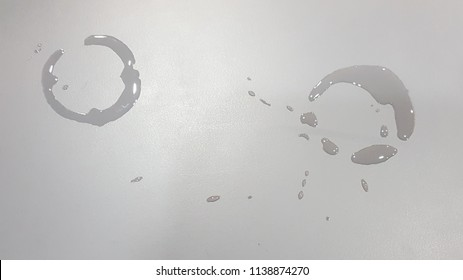 Glass stains and drops of water on gray table background