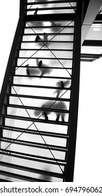 glass stairs abstract, upwards view, soles of shoes visible