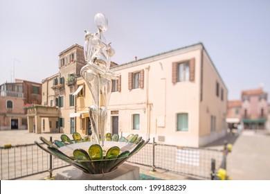Glass statueof woman on Murano or Burano island in Venice, Italy