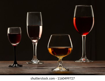 Glass still life image A glass of red wine in a glass on a black background