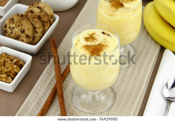 Glass with sweet banana pudding dessert