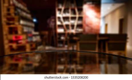 Glass table top with blurred bar background. Space for advertising products.