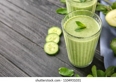 Glass of tasty avocado smoothie on wooden table