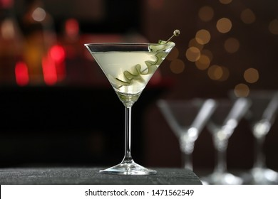 Glass of tasty cucumber martini on bar counter