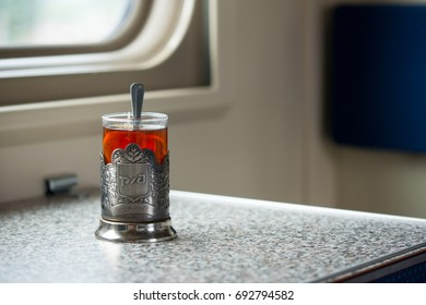 A glass of tea in the cup holder, on the table in the train. Russia, second-class carriage. 21.07.2016
