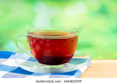 glass of tea on green background