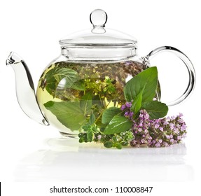 A glass tea pot with fragrant herbs isolated on a white background
