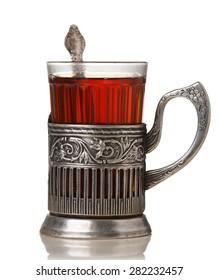 Glass of tea in vintage glass-holder (podstakannik)