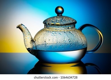Glass teapot with boiling water and drops of condensation