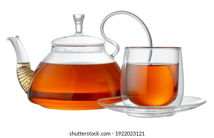 Glass teapot and glass cup with tea isolated on white