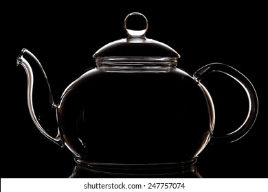 Glass teapot isolated on black