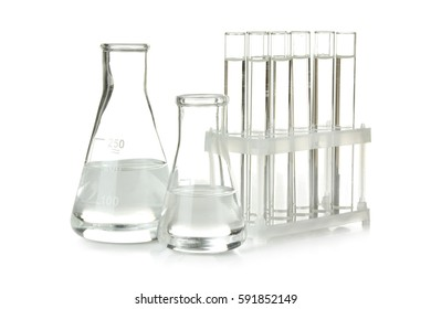 Glass test tubes and flasks with water isolated on white