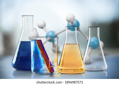 Glass test tubes with liquid stand on a table in a chemical laboratory. Checking the quality of petroleum products refining concept.