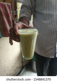 glass of thandai, a north-indian drink made with chilled milk, sugar nuts and condiments , sometimes infused with bhang or cannabis leaves to make it highly intoxicating.