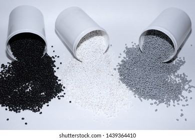 Glass with thermoplastic elastomer granules on white background