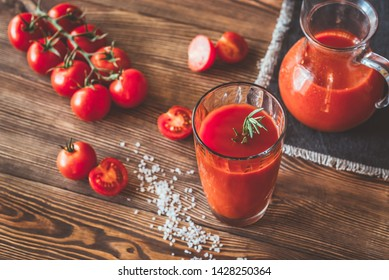 A glass of tomato juice with cherry tomatoes