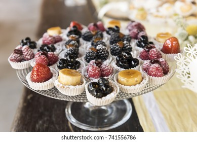 glass tray with mix fruit pastries, shallow depth of field