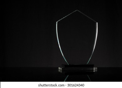 glass trophy in black background
