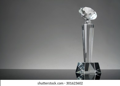 glass trophy in gray background