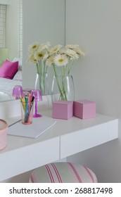 glass vase of flower on white dressing table at home