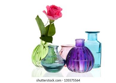 Glass vases rose flower isolated over white background