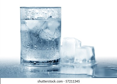 Glass of very cold water with ice cubes. Isolated with clipping path