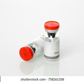 Glass vials for liquid samples. Laboratory equipment for dispensing fluid samples with text copy space isolated on white background