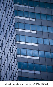 Glass wall of business center building and sky reflection, abstract view