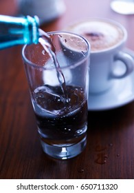 Glass of water and Cappuccino