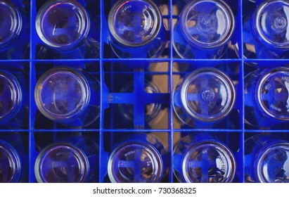 A glass of water in a crate on a loan borrowed from a temple in Surat Thani, Thailand.