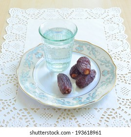 A glass of water and dates- a food to break fast during holy month of Ramadan