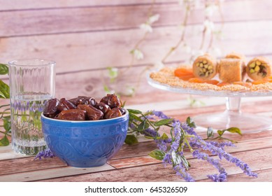 A glass of water and dates used for breaking the fast during the Islamic fasting of Ramadan.