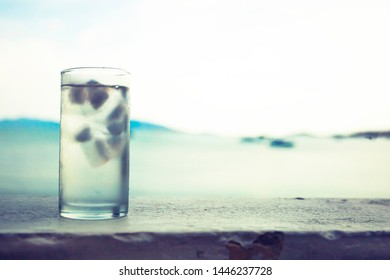 the glass of water in hot summer day
