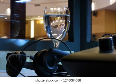 A glass of water for the interpreter in a special cabin of simultaneous translation