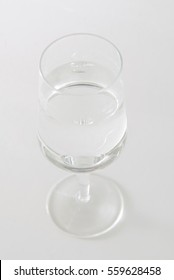 A glass of water isolated on gray background