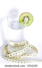 Glass of water with kiwi isolated on white