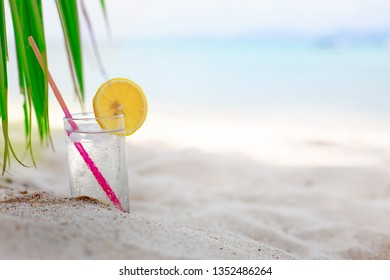 glass of water with lemon at hot summer day