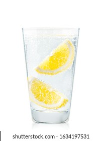 Glass of water with lemon slices in close-up on a white background. Isolated