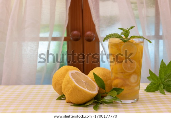 A glass of water with lemon wedges